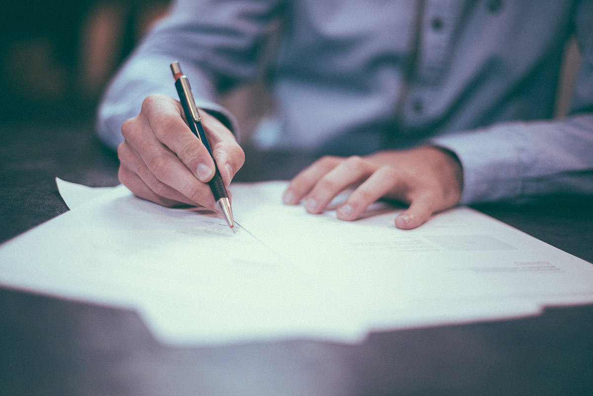 Man signing a paper document