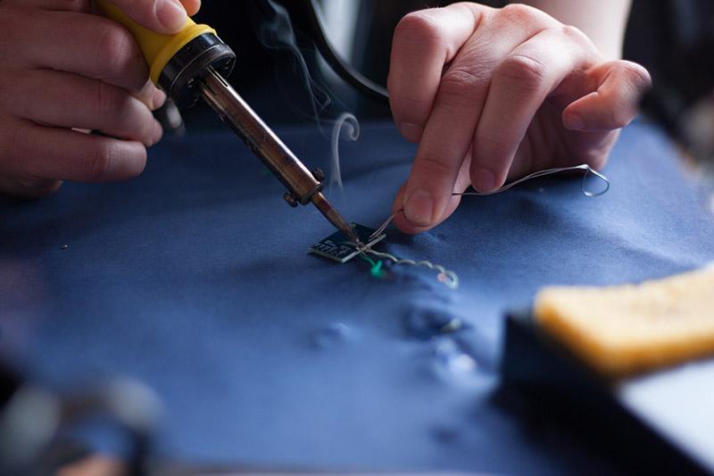 Man soldering a microchip
